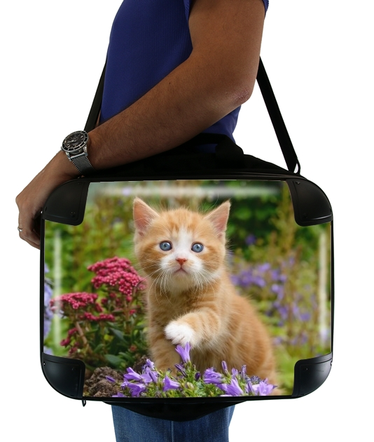 Cute ginger kitten in a flowery garden, lovely and enchanting cat para bolso de la computadora